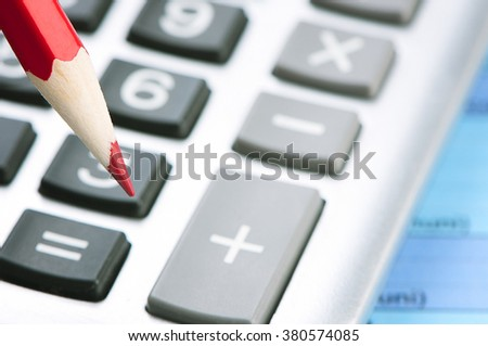 Red pencil on a calculator