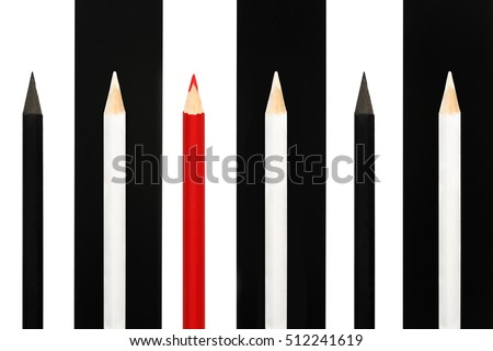 Red pencil standing out from crowd of black and white fellows on b/w stripe background. business success concept of leadership uniqueness, independence, initiative, strategy, dissent, think different