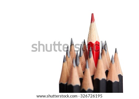 Red pencil standing out from crowd of plenty identical black fellows on white background. Leadership, uniqueness, independence, initiative, strategy, dissent, think different, business success concept - stock photo