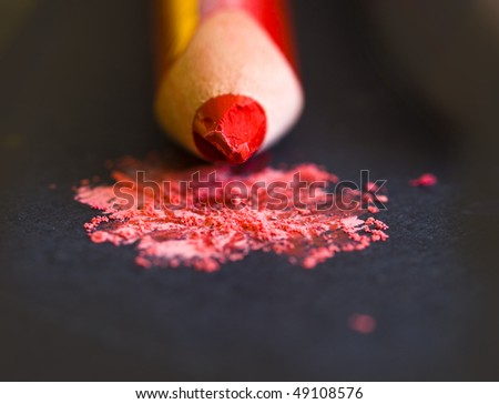 red pencil with shaving