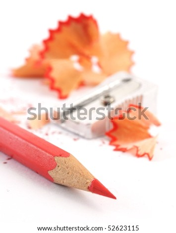 red pencil with shavings isolated on with background - stock photo