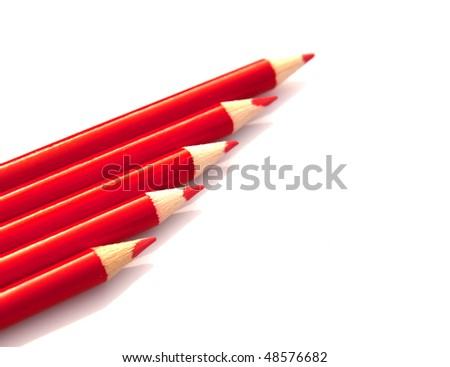 Red pencils on white background