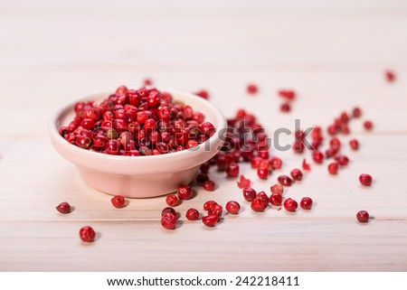 Red pepper,  peppercorns in bowl. hot spices - stock photo