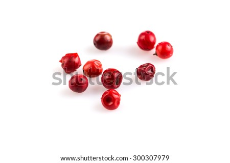 red peppercorns seeds isolated on white background - stock photo