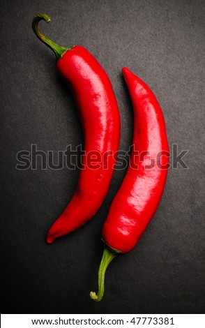 Red peppers in a pose 96 - stock photo