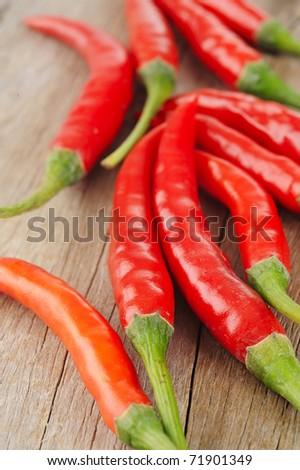 red peppers on wood background
