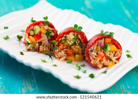 Red peppers stuffed with tuna salad - stock photo