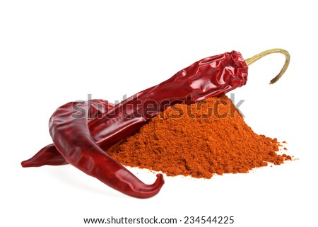 Red peppers with its powder on a white background - stock photo
