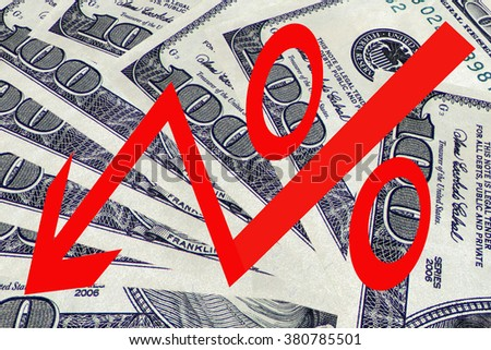 Red percentage symbol on the background of banknotes - stock photo