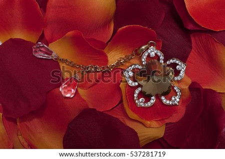 Red petals and necklace