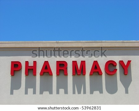 red pharmacy sign with long shadow and room for text - stock photo