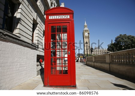 Red phone booth and Big Ben. Red phone booth is one of the most famous icons of London. - stock photo