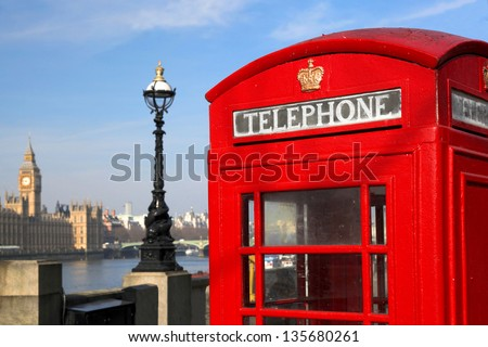 Red phone boxes against Big Ben in London, UK - stock photo