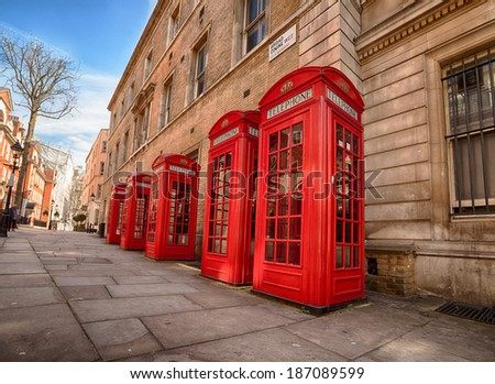 red phone boxes in Covent Garden at day - stock photo