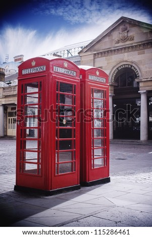 Red phone boxes in Covent Garden Market - stock photo