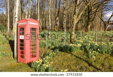 Red phone on abandoned field - stock photo