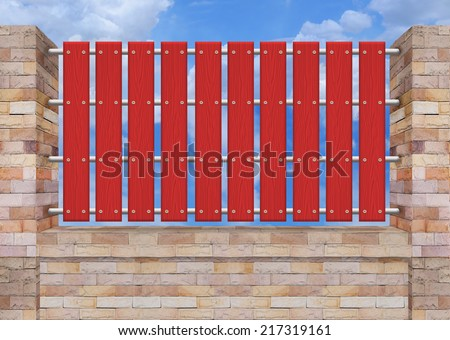 Red picket fence, brick wall. - stock photo