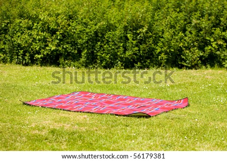 red picnic blanket, carpet, summer or spring concept shoot - stock photo