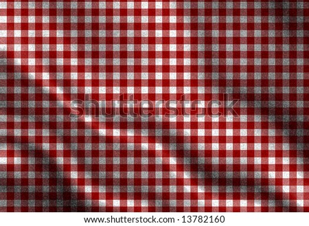 red picnic cloth with some folds in it - stock photo
