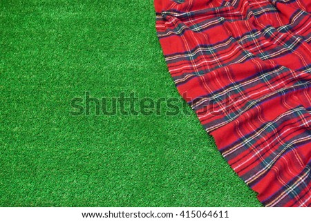 Red Picnic Tartan Empty Blanket On The Fresh Trimmed Grass In Summertime, Top View - stock photo