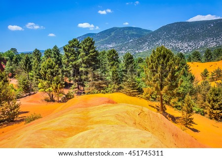 Red picturesque hills. Languedoc - Roussillon, Provence, France. The reserve - pit on production ochre