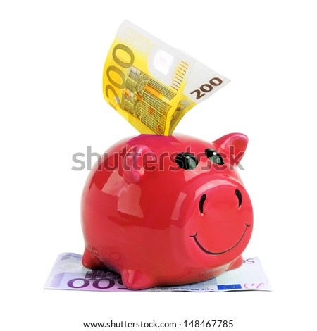 Red piggy bank with Euro money isolated on white background - stock photo