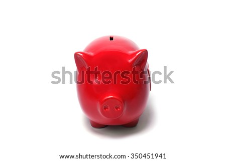 Red piggy coin bank on white background - stock photo