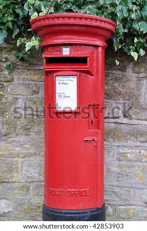 Red Pillar Type Post Box, Showing Close up Detail - stock photo