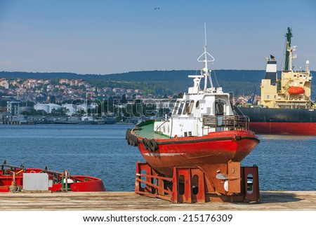 Red pilot boat stands on the pier in Varna port, Bulgaria
