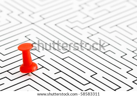Red pin, off center in labyrinth