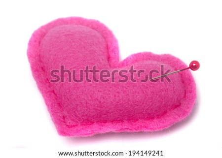 Red/pink heart shape symbol with needle isolated on white background - stock photo