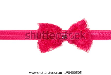 Red-pink ribbon bow isolated on white background. Adornment for the head. - stock photo