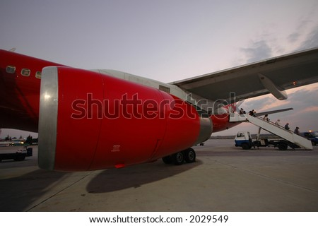 Red plane in an airport. - stock photo