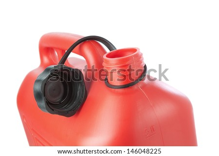 Red plastic canister for transportation of gasoline. On a white background. - stock photo