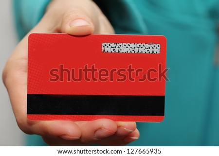 red plastic card in hand