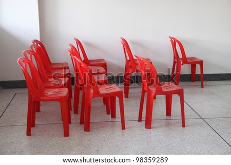 Red plastic chairs - stock photo