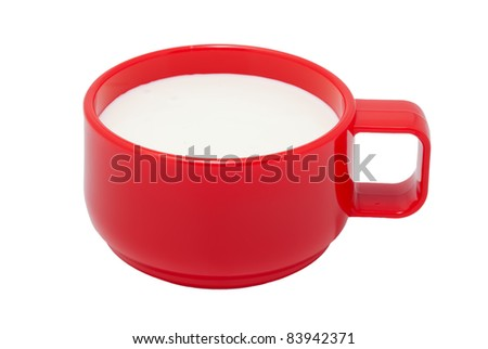 Red plastic cup with kefir. On a white background - stock photo