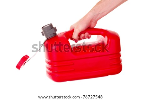 Red plastic fuel canister in hand isolated on white - stock photo