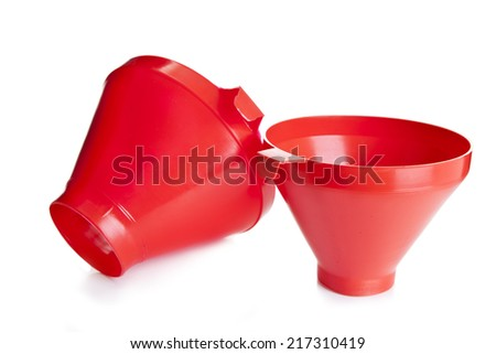red plastic funnel isolated on white - stock photo