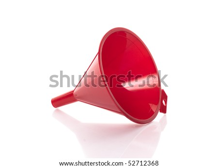 Red plastic funnel on white background - stock photo