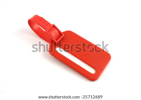 red plastic luggage label close up isolated - stock photo