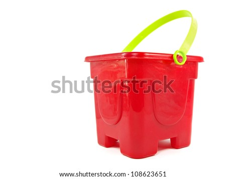 red plastic toy pail on a white background