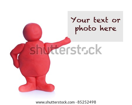 Red plasticine man holding and showing a blank card with copy-space for your text or image on white background - stock photo