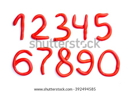 Red plasticine numbers on white background - stock photo