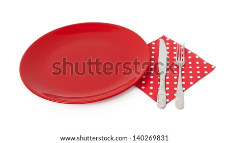 Red plate and cutlery - stock photo