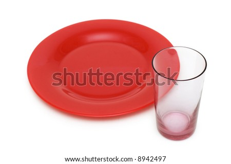 Red plate and glass isolated on white