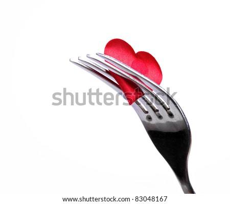 Red plug near heart symbol - stock photo
