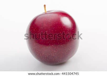 Red plum on white background. Studio shoot.