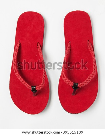 red plush thongs isolated with shadows - stock photo