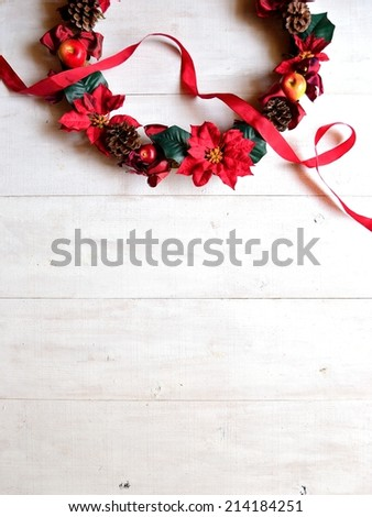 Red poinsettia Christmas wreath with ribbon - stock photo